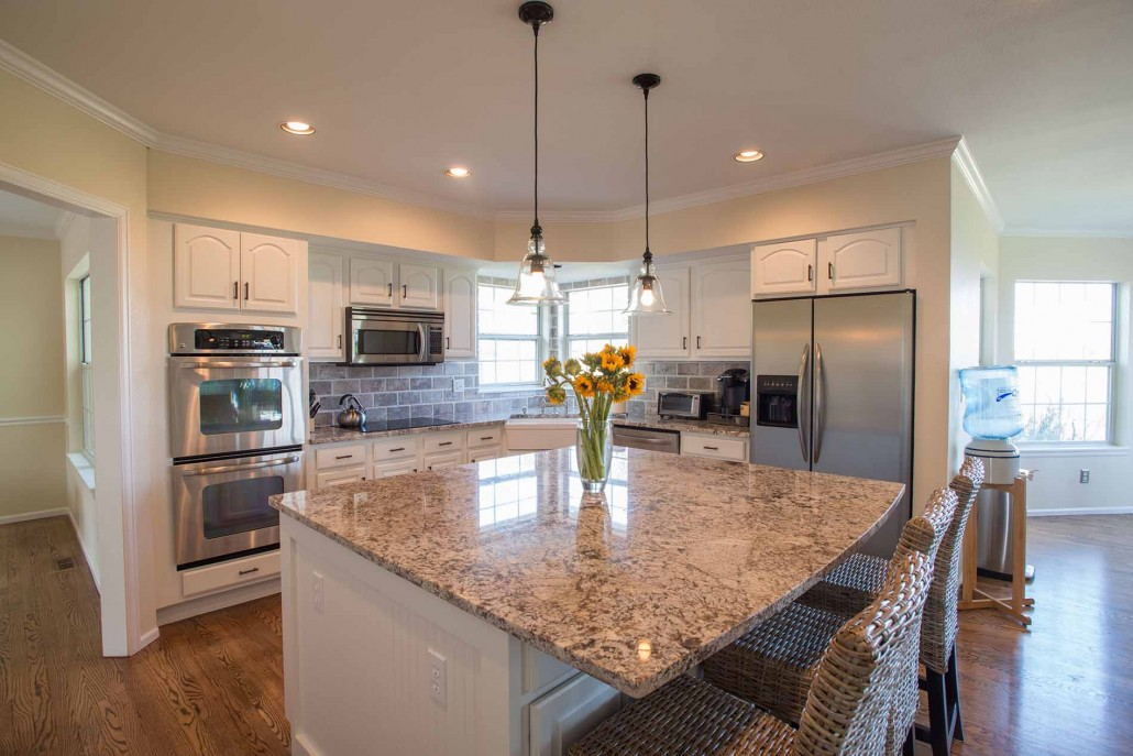 White kitchen cabinet painting in Denver